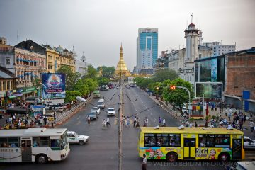 British, Buddhist and modern architecture coexist and look over Rangoon bustling life.