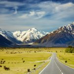 Visit-New-Zealand-Landscape-With-Road-and-Snowy-Mountains-Southern-Alps-New-Zealand-1600×1047